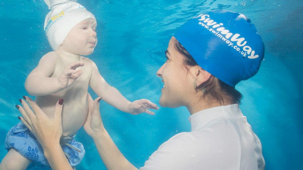 image of a swimway instructor teaching a child underwater