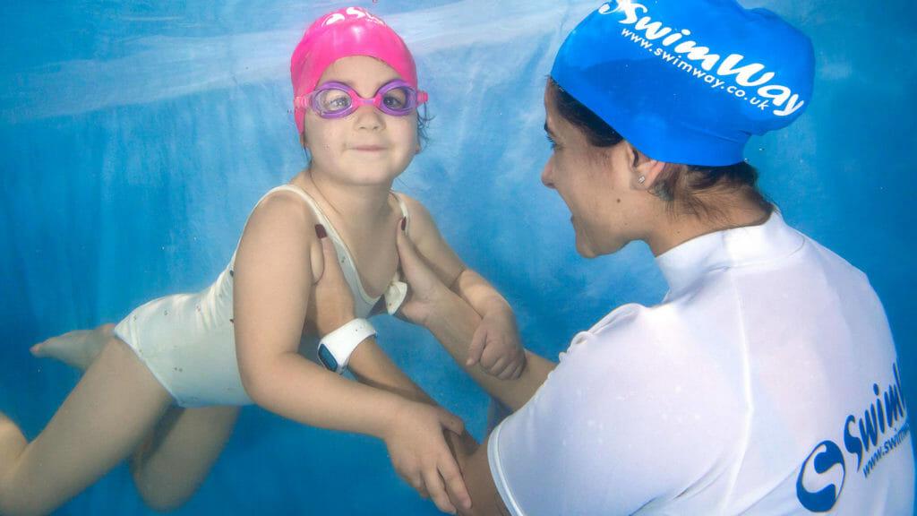 swimway teacher and child underwater photograph