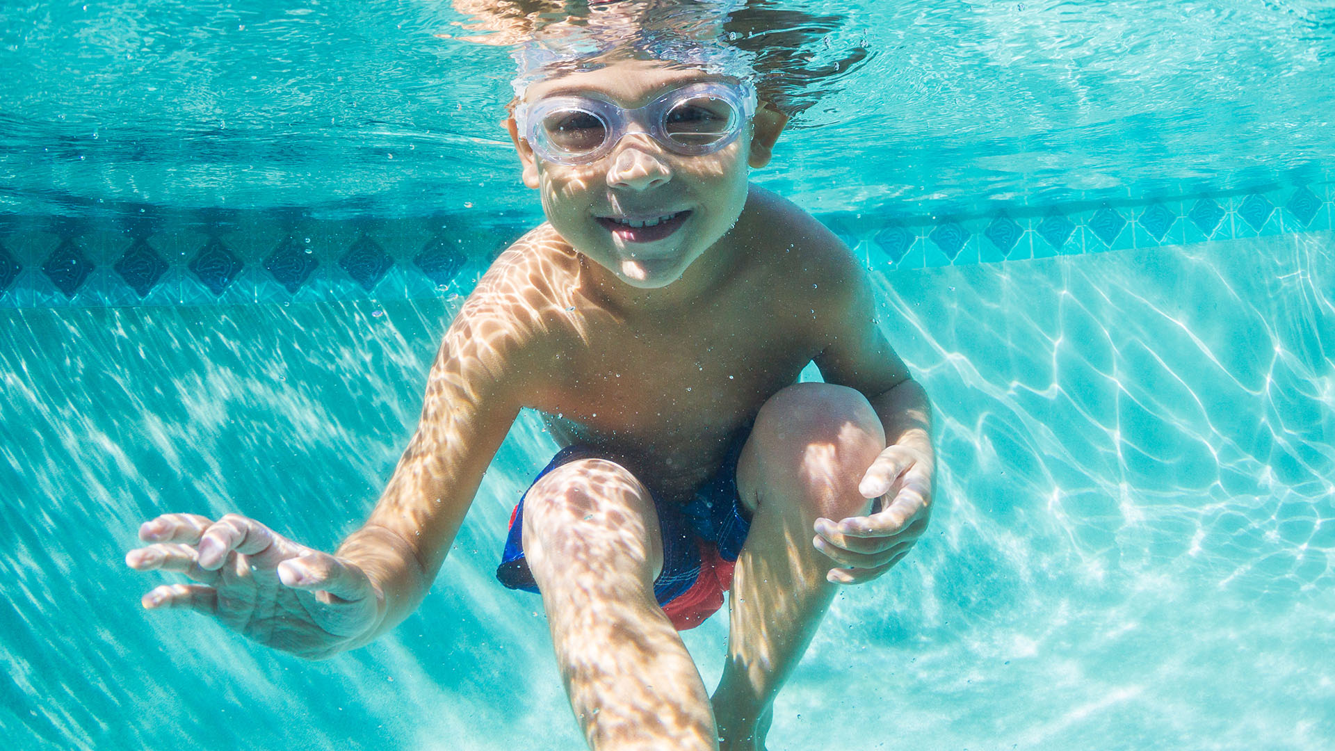 adobe photograph happy child underwater